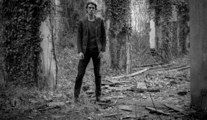 Photo of Psychedelic Indie Rock Music Artist Samuel Christen, full body photo with background ruins