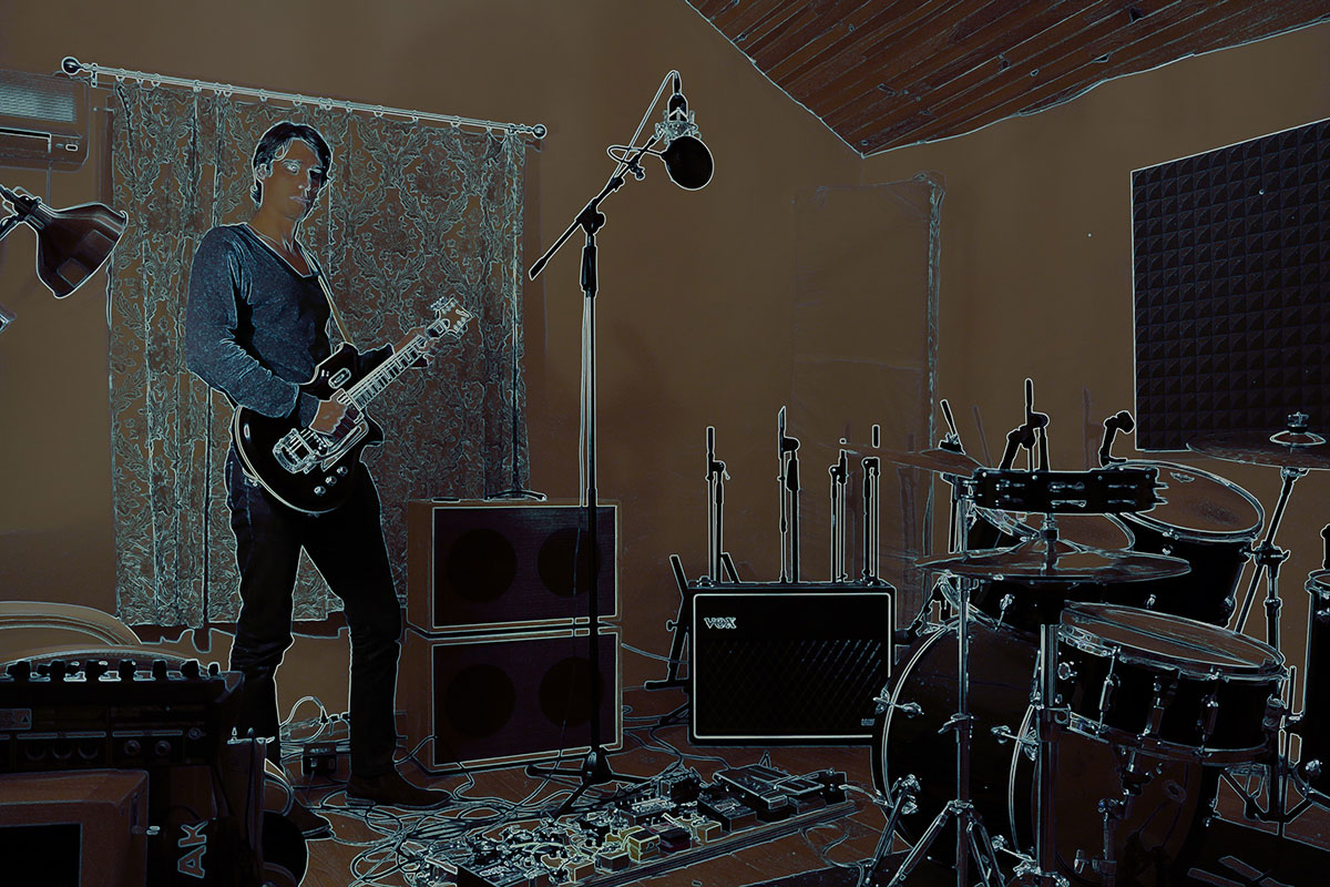 Photo of Psychedelic Indie Rock Music Artist Samuel Christen, full body photo in his home studio