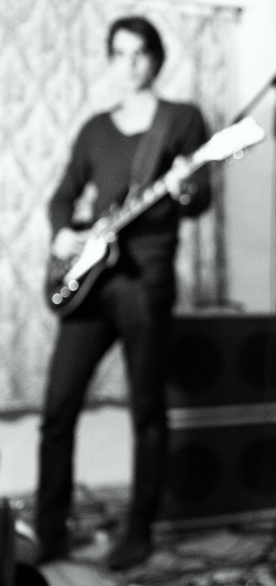 Photo of Psychedelic Indie Rock Music Artist Samuel Christen, full body photo playing guitar